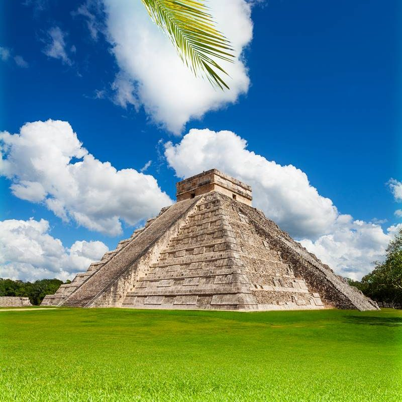Nice view of Chichen, Itza monument, Mexico on green grass